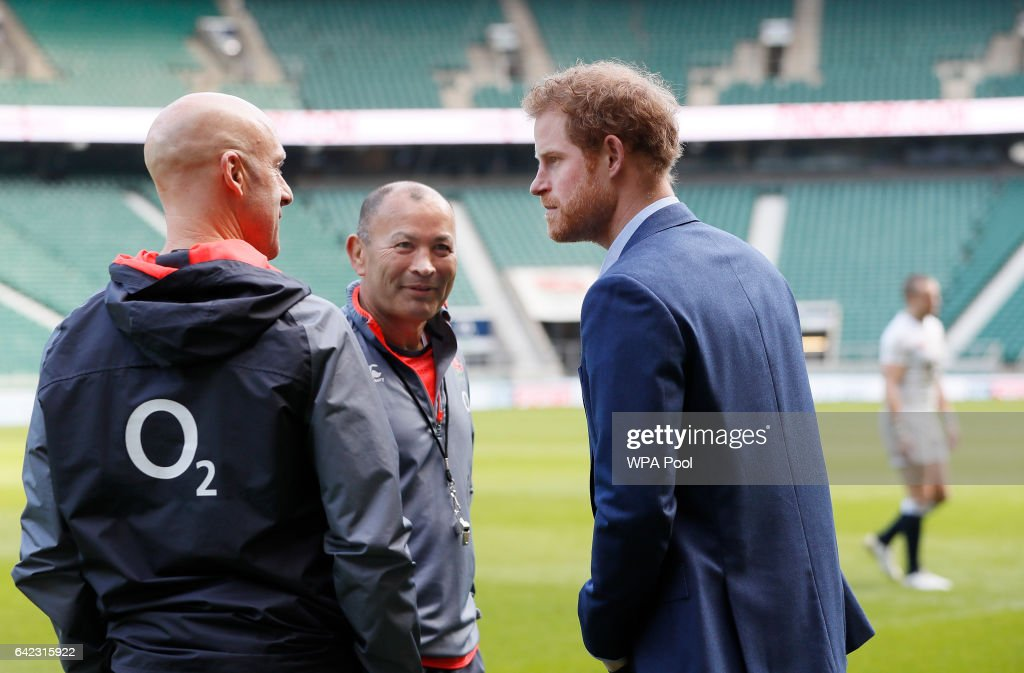 Britain's Prince Harry, (R) speaks with England Coach Eddie Jones, (C) during a visit to an England Rugby Squad training session at Twickenham Stadium on February 17, 2017 in London, England. In his new role as Patron of the Rugby Football Union (RFU), Prince Harry attended the England rugby team open training session.