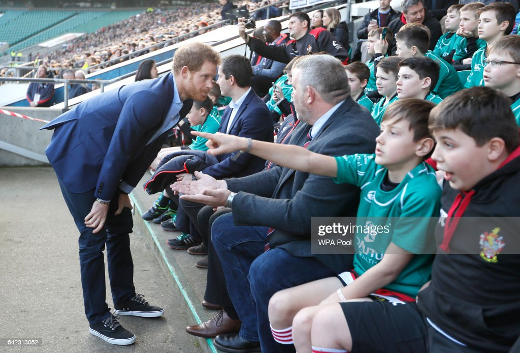 Britain's Prince Harry speaks with people from the Kids First, Didcot RFU during a visit to an England Rugby Squad training session at Twickenham Stadium on February 17, 2017 in London, England. In his new role as Patron of the Rugby Football Union (RFU), Prince Harry attended the England rugby team open training session.