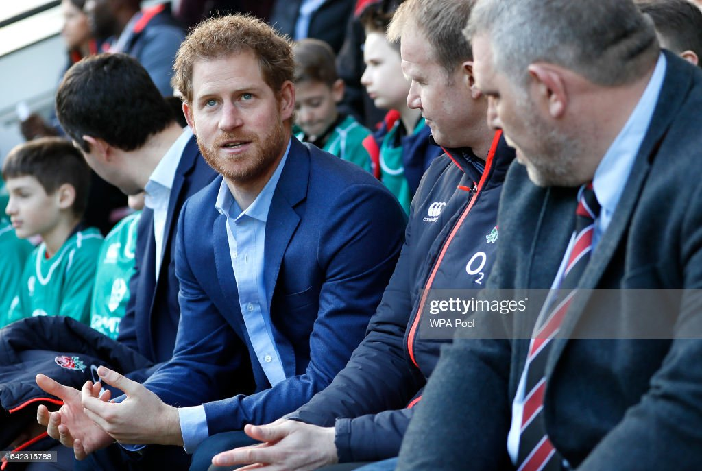 Britain's Prince Harry speaks with people from the Kids First, Didcot rfc during a visit to an England Rugby Squad training session at Twickenham Stadium on February 17, 2017 in London, England. In his new role as Patron of the Rugby Football Union (RFU), Prince Harry attended the England rugby team open training session.