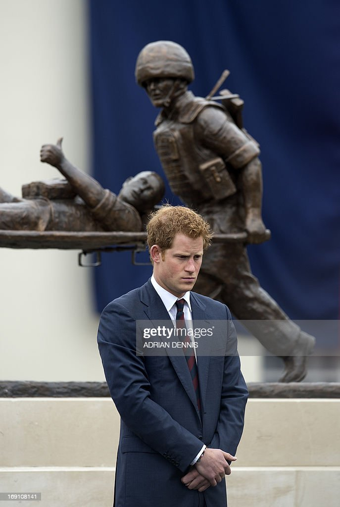 Britain's Prince Harry stands in front of a statue during a visit to Tedworth House, a recovery centre run by the Help for Heroes charity that offers care and support to injured service personnel, in Tidworth, Wiltshire, southern England, on May 20, 2013. The Duke of Cambridge and Prince Harry will officially open four new Help for Heroes recovery centres, which form part of the Defence Recovery Capability. Prince William and Harry met wounded service personnel, veterans and their families to learn about the challenges they face. Help for Heroes is building, equipping and running four recovery centres to provide ongoing support for wounded, injured and sick service personnel and veterans. Tedworth House is the first centre to open, and has the capacity to accommodate 50 residents, 4 families and over 150 day visitors.