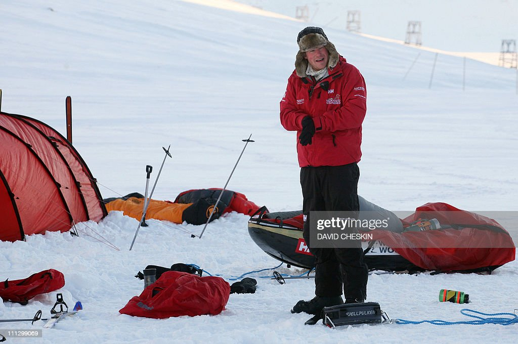 Britain's Prince Harry takes down his tent during training with the Walking with the Wounded team as they prepare to set off to walk to the North Pole, on the island of Spitsbergen, situated between the Norwegian mainland and the North Pole, on March 31, 2011. Britain's Prince Harry will join the team for the first five days of the trek to the North Pole. The team's expedition will last four weeks and see them cover up to 200 miles (320 kilometres) of the frozen Arctic Ocean on foot, pulling their own equipment in temperatures as low as minus 60 degrees Centigrade. AFP PHOTO/David Cheskin/WPA