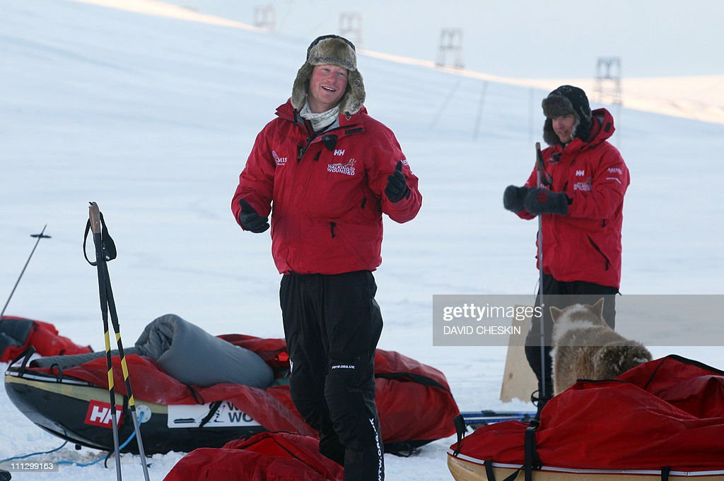 Britain's Prince Harry (L) takes down his tent during training with the Walking with the Wounded team as they prepare to set off to walk to the North Pole, on the island of Spitsbergen, situated between the Norwegian mainland and the North Pole, on March 31, 2011. Britain's Prince Harry will join the team for the first five days of the trek to the North Pole. The team's expedition will last four weeks and see them cover up to 200 miles (320 kilometres) of the frozen Arctic Ocean on foot, pulling their own equipment in temperatures as low as minus 60 degrees Centigrade. AFP PHOTO/David Cheskin/WPA