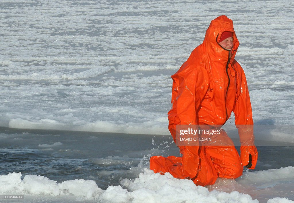 Britain's Prince Harry tries out an immersion suit as he joins the Walking with the Wounded team for training on the island of Spitsbergen, situated between the Norwegian mainland and the North Pole, on March 30, 2011 for their last days of packing before setting off to walk to the North Pole. The team's expedition will last four weeks and see them cover up to 200 miles (320 kilometres) of the frozen Arctic Ocean on foot, pulling their own equipment in temperatures as low as minus 60 degrees Centigrade. AFP PHOTO/David Cheskin/WPA