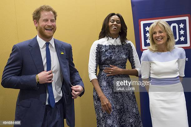 Britain's Prince Harry US First Lady Michelle Obama and Jill Biden wife of the US Vice President laugh as they listen to a music presentation by...