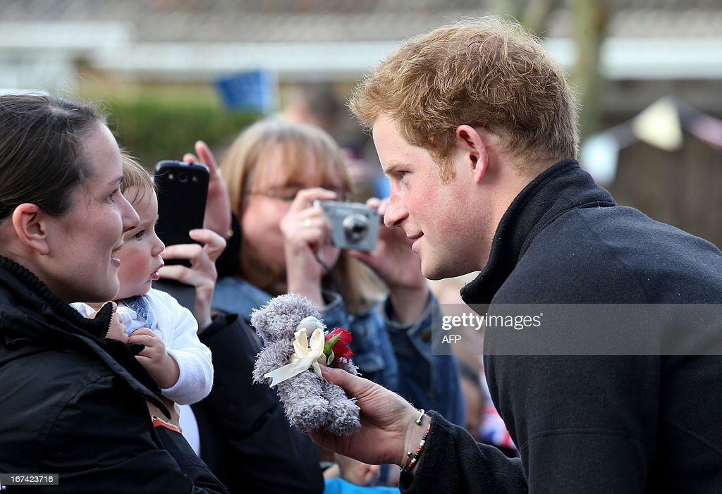 Britain's Prince Harry visits the Headway brain injury association as he officialy opens the Bradbury House, the charity's new headquarters, in Nottingham on April 25, 2013.