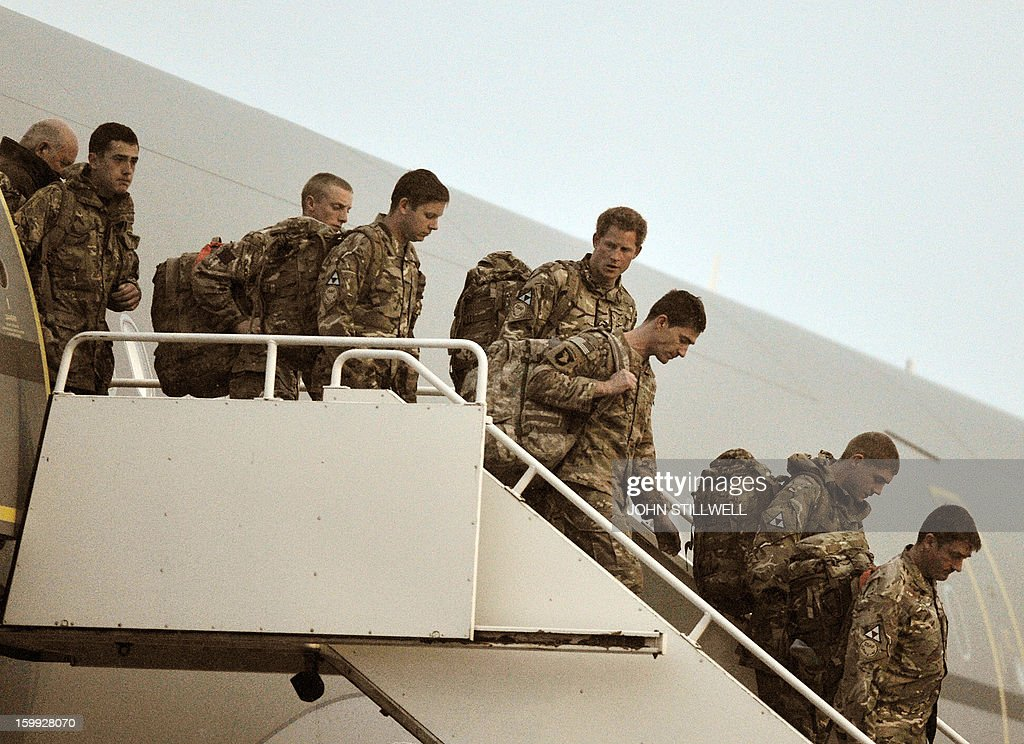 Britain's Prince Harry (4R) walks down the steps of a British Royal Air Force A-330 transport aircraft as he arrives home at RAF Brize Norton in Oxfordshire on January 23, 2013 after completing his 20-week tour of duty in Afghanistan as an Apache helicopter pilot/gunner with 662 Squadron of the Army Air Corps. Harry, third in line to the throne, said he killed Taliban fighters during his 20-week posting in the restive southern Helmand Province it was reported at the end of his tour of duty on January 21.