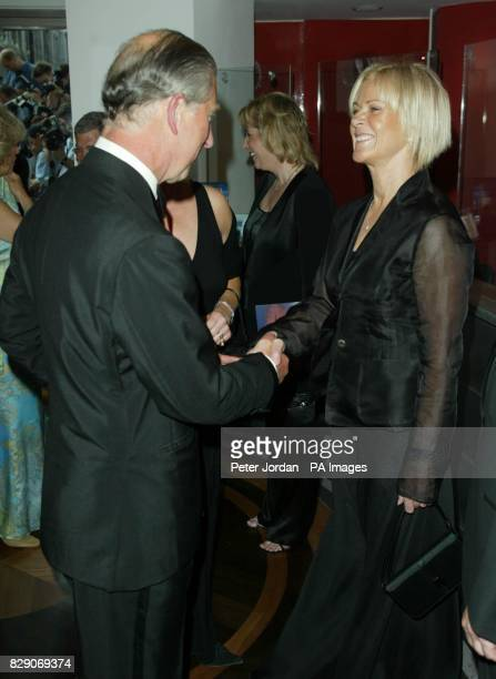 Britain's Prince of Wales meets AnniFrid Prinzessin Reuss at the Prince of Wales Theatre in London for the reopening of the hit muscal Mama Mia