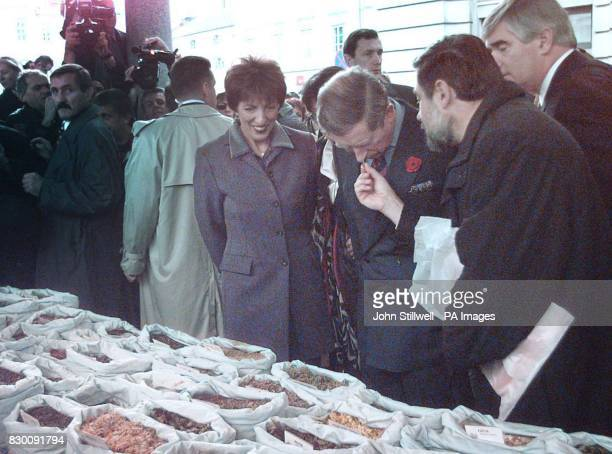 Britain's Prince of Wales smells some spices as he tours the old market in Ljubijana Slovenia Tuesday Nobember 3 1998 the Prince was visiting the...