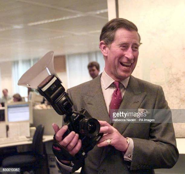 Britain's Prince of Wales smiles after taking a picture Wednesday of the Press Association's John Stillwell with one of the newest digital cameras...