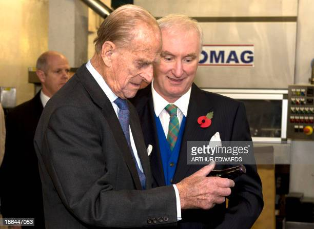 Britain's Prince Philip Duke of Edinburgh looks at the label on a bottle of Elizabethan ale during a visit to Harvey's Brewery in Lewes East Sussex...