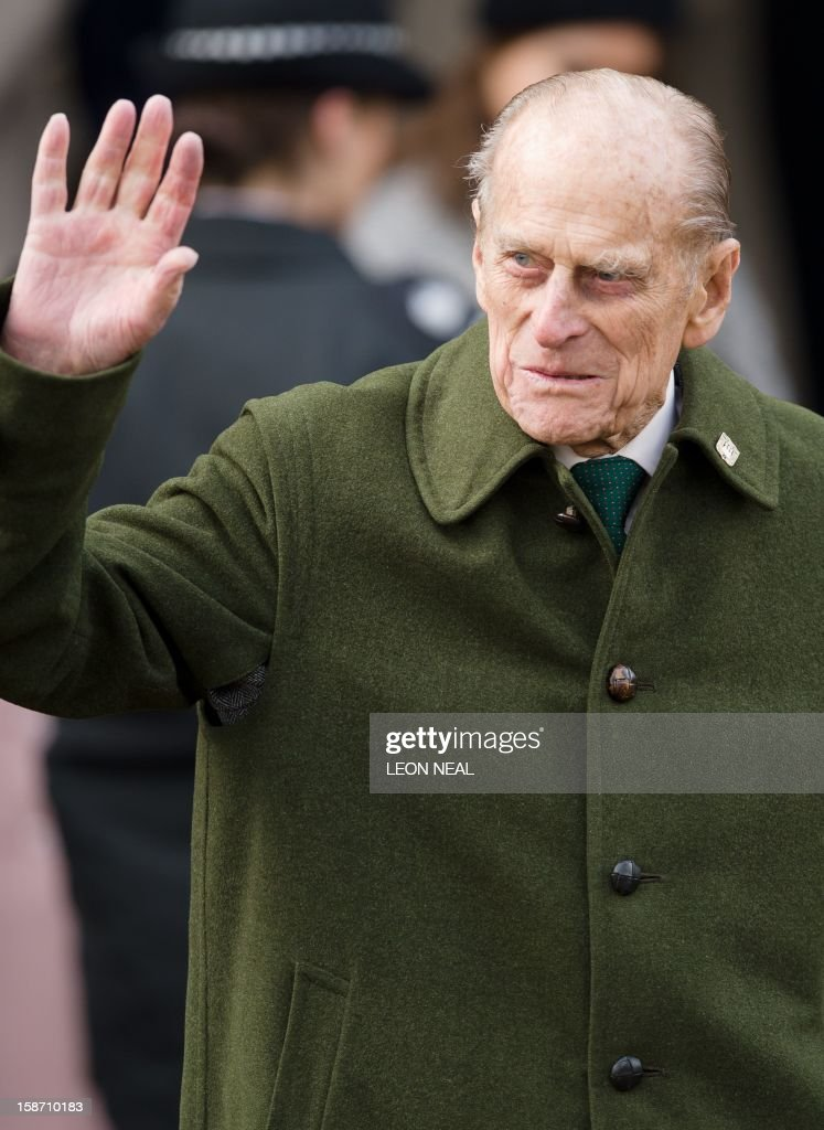 Britain's Prince Philip, Duke of Edinburgh waves to well-wishers as he leaves following the Royal family Christmas Day church service at St Mary Magdalene Church in Sandringham, Norfolk, in the east of England, on December 25, 2012.
