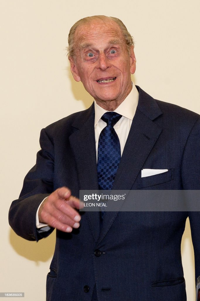 Britain's Prince Philip gestures after watching pupils of the Broadland School of Dance in the ACT centre of the St Michael's Care Complex in Aylsham, eastern England, during an official visit on October 8, 2013.