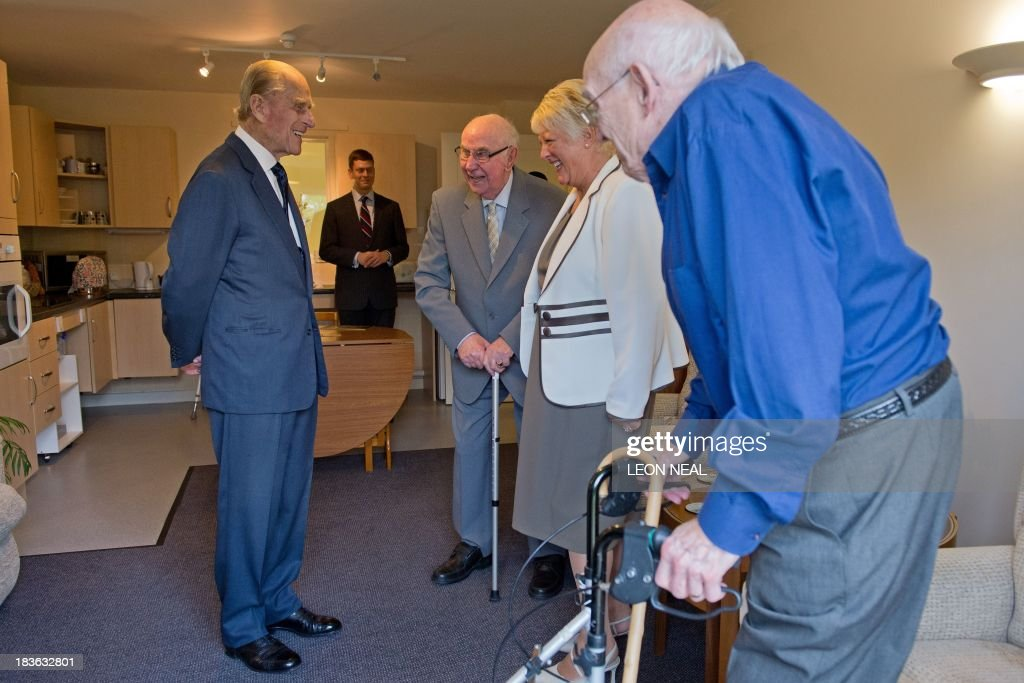 Britain's Prince Philip (L) meets residents of the Green Lane View assisted living residence at the St Michael's Care Complex in Aylsham, eastern England, during an official visit on October 8, 2013.