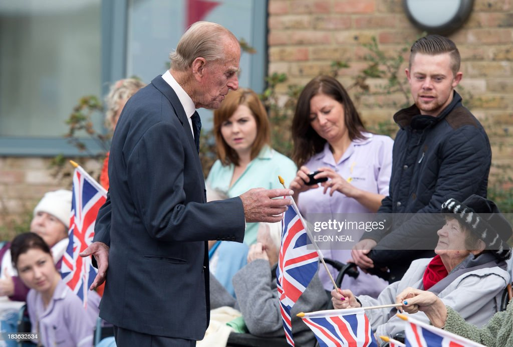 Britain's Prince Philip meets residents of the St Michael's Care Complex in Aylsham, eastern England, during an official visit on October 8, 2013. AFP PHOTO / LEON NEAL / POOL