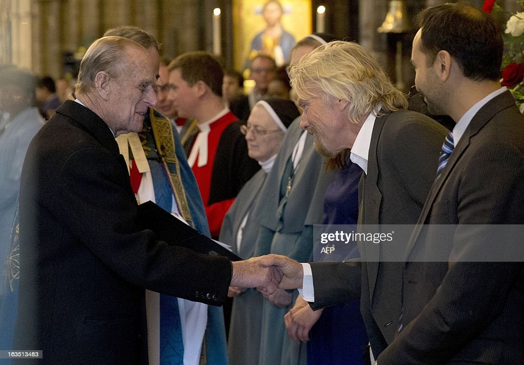 Britain's Prince Philip, the Duke of Edinburgh (L) shakes hands with British entrepreneur Richard Branson as he leaves the Commonwealth Day Observance at Westminster Abbey in London on March 11, 2013. Britain's Queen Elizabeth II missed the Commonwealth Day service in London as she is still recovering from the symptoms of gastroenteritis, Buckingham Palace said. Her 91-year-old husband Prince Philip represented her at the service, which was attended by Commonwealth ambassadors, or high commissioners, from around the world and featured an address from Virgin tycoon Richard Branson. AFP PHOTO/POOL/Matt Dunham