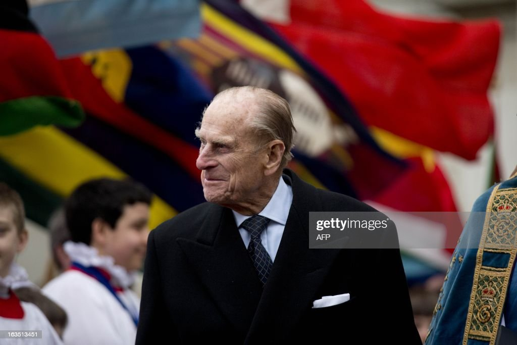 Britain's Prince Philip, the Duke of Edinburgh walks out under various flags of Commonwealth nations as he leaves the Commonwealth Day Observance at Westminster Abbey in London on March 11, 2013. Britain's Queen Elizabeth II missed the Commonwealth Day service in London as she is still recovering from the symptoms of gastroenteritis, Buckingham Palace said. Her 91-year-old husband Prince Philip represented her at the service, which was attended by Commonwealth ambassadors, or high commissioners, from around the world and featured an address from Virgin tycoon Richard Branson. AFP PHOTO/POOL/Matt Dunham