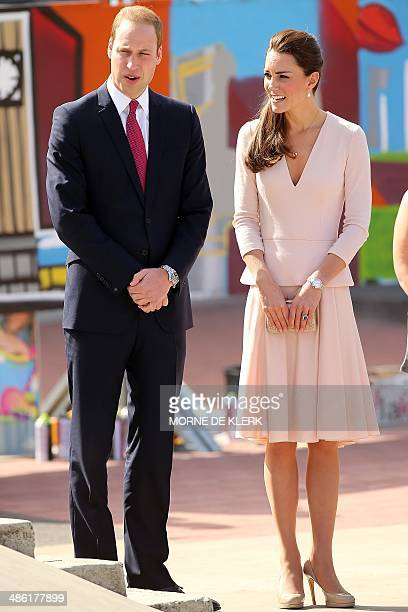 Britain's Prince William and and his wife Catherine the Duchess of Cambridge are shown through a skate park in Elizabeth a suburb of Adelaide on...