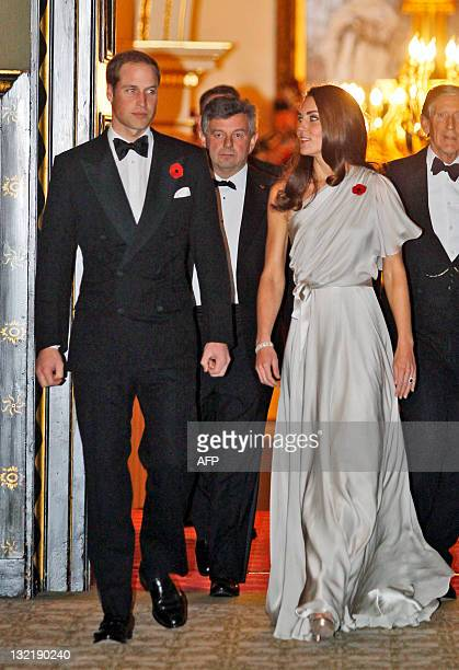 Britain's Prince William and Catherine Duchess of Cambridge arrive to attend a dinner reception in aid of the National Memorial Arboretum Appeal at...