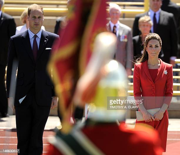 Britain's Prince William and Catherine Duchess of Cambridge attend a ceremony at the Challenger Rotary Park in Calgary Alberta on their nineday tour...