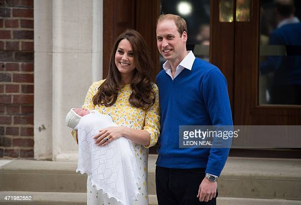 Britain's Prince William and Catherine Duchess of Cambridge show their newlyborn daughter their second child to the media outside the Lindo Wing at...