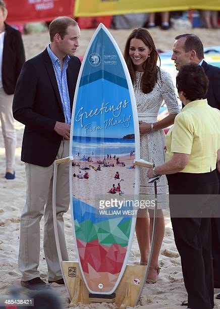 Britain's Prince William and Catherine the Duchess of Cambridge chat with Australian Prime Minister Tony Abbott as they are presented with a...