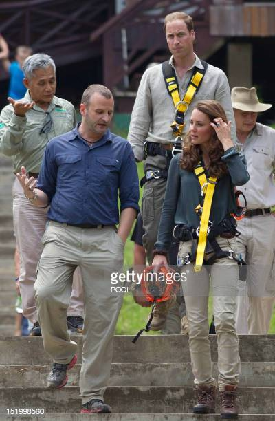 Britain's Prince William and Catherine the Duchess of Cambridge walk during a tour of the Borneo Rainforest Research Center in Danum Valley some 70...