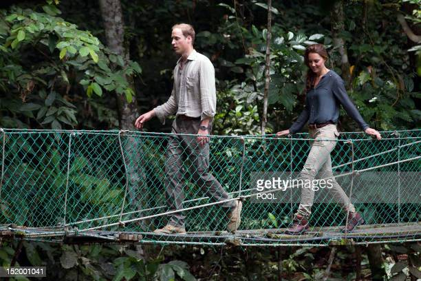 Britain's Prince William and Catherine the Duchess of Cambridge walk across a bridge at the Borneo Rainforest Research Center in Danum Valley some 70...