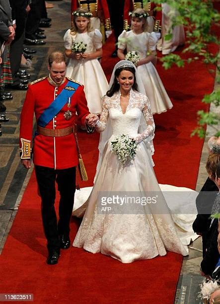 Britain's Prince William and his bride Kate Duchess of Cambridge leave Westminster Abbey in London on April 29 after their wedding ceremony AFP PHOTO...