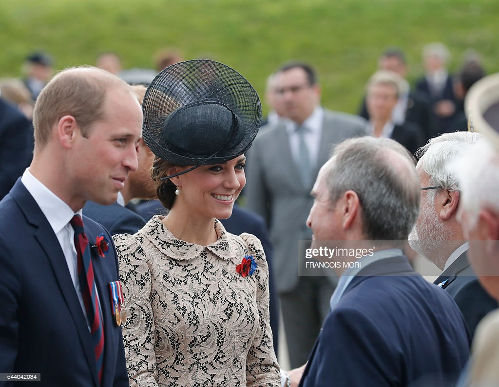 Britain's Prince William (L) and his wife Britain's Catherine, Duchess of Cambridge (C) speak with French officials as they arrive in Thiepval, northern France, on July 1, 2016 to attend the Somme battle's centenary commemorations. One week after Britain's vote to leave the European Union, Prime Minister David Cameron and royal family members will stand side-by-side with France's President to celebrate their historic alliance at the centenary of the deadliest battle of World War I. / AFP / POOL / Francois Mori