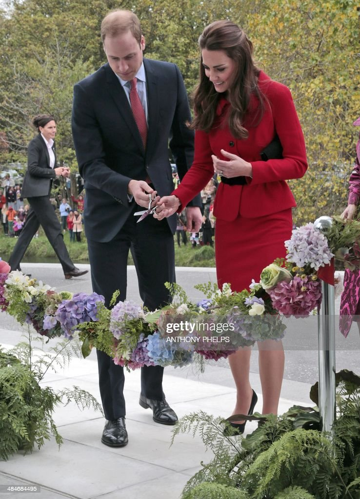 Britain's Prince William and his wife Catherine Duchess of Cambridge cut the ribbon at a ceremony to open the new visitors centre in the Christchurch...