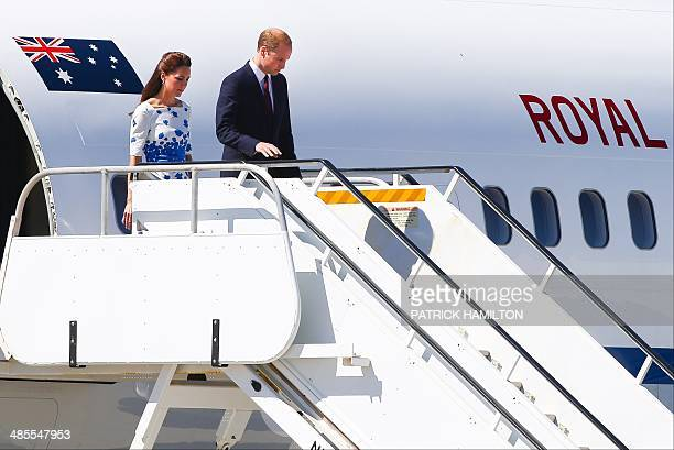 Britain's Prince William and his wife Catherine Duchess of Cambridge arrive at RAAF Amberley in Brisbane on April 19 2014 Britain's Prince William...