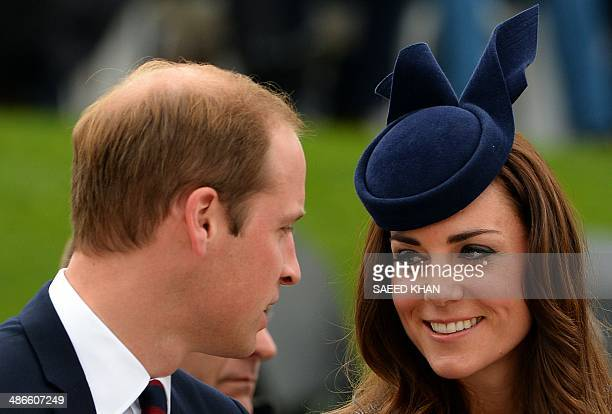 Britains Prince William and his wife Catherine Duchess of Cambridge share a smile during the ANZAC Day march at the Australian War Memorial in...