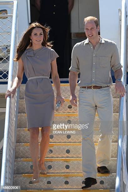 Britain's Prince William and his wife Catherine the Duchess of Cambridge arrive at Ayres Rock Airport near Yulara on April 22 2014 Britain's Prince...
