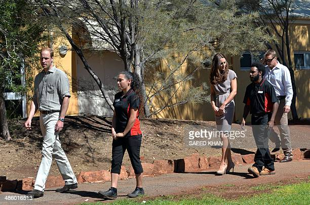 Britain's Prince William and his wife Catherine the Duchess of Cambridge arrive to distribute certificates to the graduating students at the National...