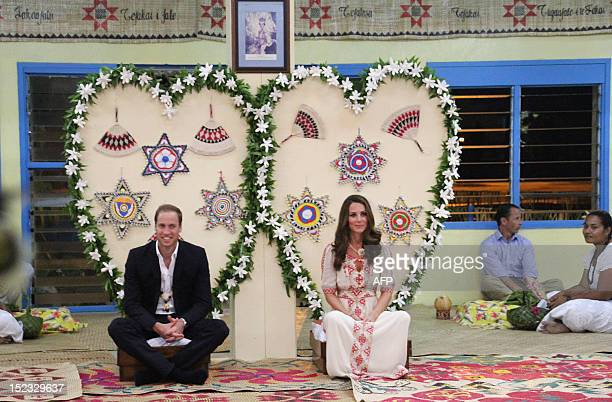 Britain's Prince William and his wife Catherine the Duchess of Cambridge attend a dinner event in Funafuti on Tuvalu on September 18 2012 Nearly half...