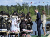 Britain's Prince William and his wife Catherine the Duchess of Cambridge greet traditional dancers during a visit to the Somba K'e Civic Plaza in...