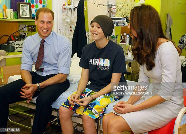 Britain's Prince William and his wife Catherine the Duchess of Cambridge meet patient Digby Davidson as they open a children's cancer unit at the...