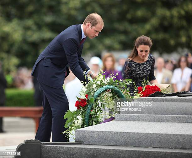 Britain's Prince William and his wife Catherine the Duchess of Cambridge place a wreath at the National War Memorial in Ottawa Canada June 30 the...