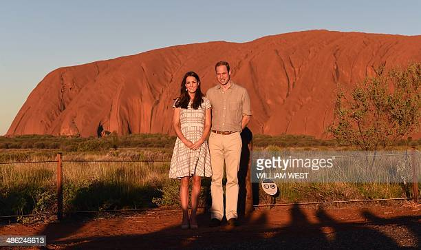 Britain's Prince William and his wife Catherine the Duchess of Cambridge stand in front of Uluru in the Northern Territory on April 22 2014 Britain's...