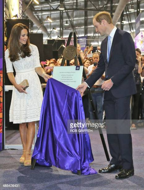 Britain's Prince William and his wife Catherine the Duchess of Cambridge unveil a plaque to mark the official opening of a new arts and craft...