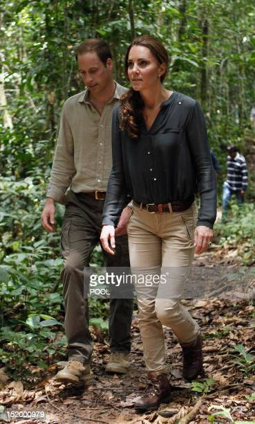 Britain's Prince William and his wife Catherine the Duchess of Cambridge walk through the rainforest in Danum Valley Research Center in Danum Valley...