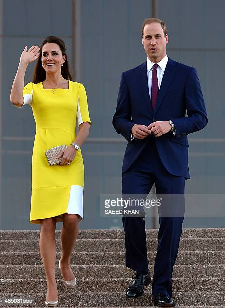 Britain's Prince William and his wife Catherine the Duchess of Cambridge walk from the top of the stairs of Sydney's iconic landmark Opera House on...
