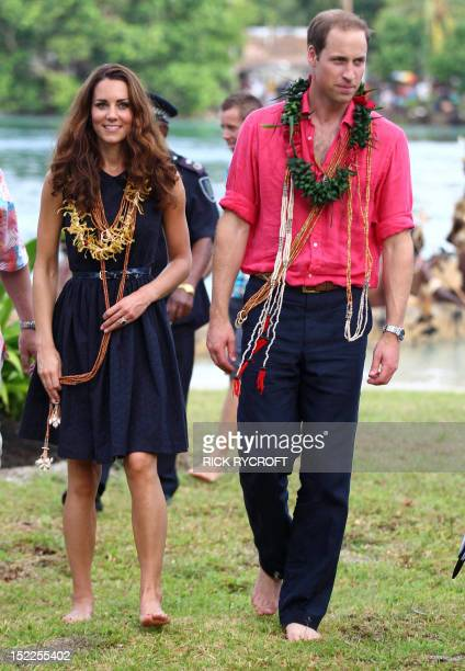 Britain's Prince William and his wife Catherine the Duke and Duchess of Cambridge arrive barefoot in Tavanipupu on September 17 2012 Britain's Prince...