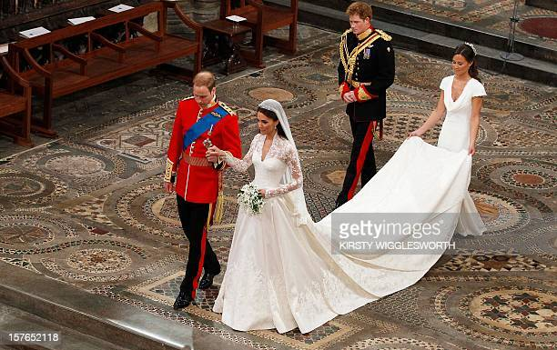 Britain's Prince William and his wife Kate Duchess of Cambridge followed by Britain's Prince Harry and Maid of Honour Philipa Middleton leave...