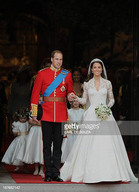 Britain's Prince William and his wife Kate Duchess of Cambridge come out of Westminster Abbey in London after their wedding service on April 29 2011...