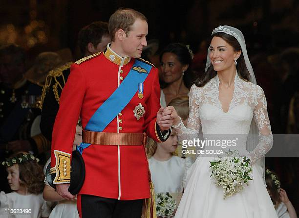 Britain's Prince William and his wife Kate Duchess of Cambridge look at each other as they come out of Westminster Abbey following their wedding...