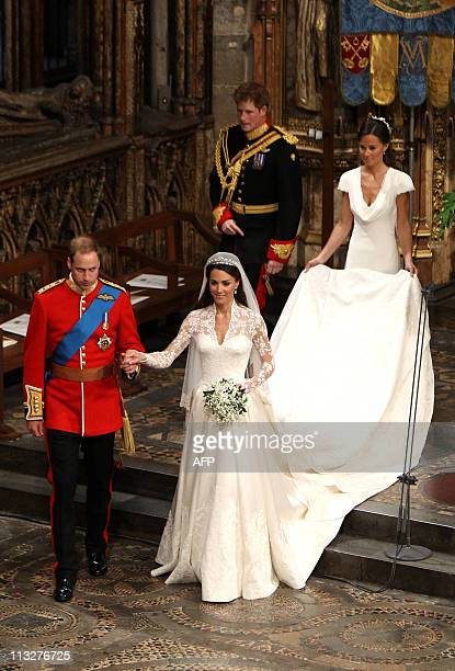 Britain's Prince William and his wife Kate Duchess of Cambridge make their way out of Westminster Abbey in London followed by Maid of Honour Philippa...