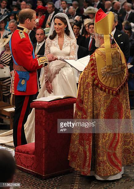 Britain's Prince William and Kate Duchess of Cambridge exchange rings in front of the Archbishop of Canterbury Rowan Williams during their wedding...