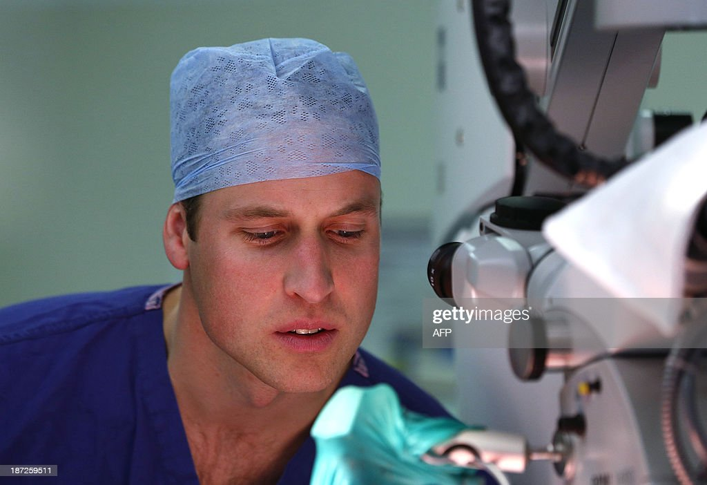 Britain's Prince William and President of the Royal Marsden NHS (National Health Service) Foundation Trust, observes breast reconstruction surgery on a female patient during an official visit to the Royal Marsden hospital in London, on November 7, 2013.