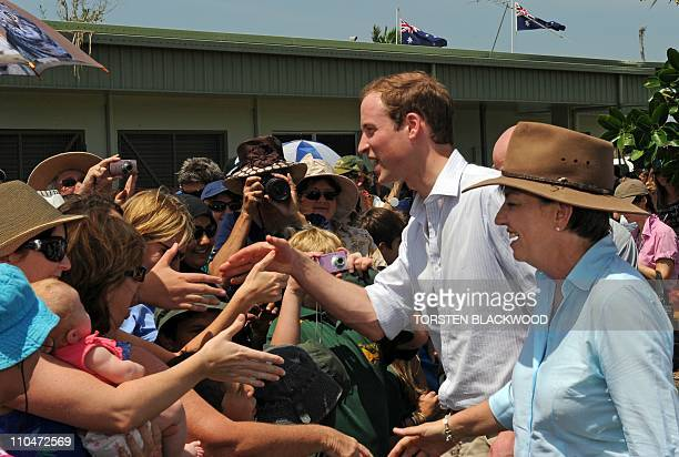 Britain's Prince William and Queensland state Premier Anna Bligh chat with wellwishers in the cyclonehit town of Cardwell on March 19 2011 Thousands...